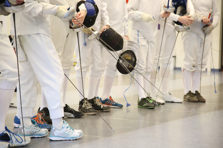 fencing: fencer with fencing mask and rapier. Sport and acitivity