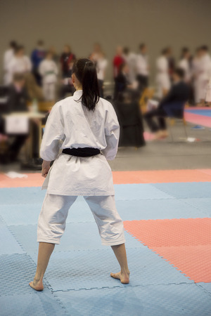 Karate girl waiting decesion of judges on tatami Stock Photo