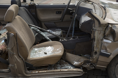 car completely destroyed with broken glass after the traffic accident