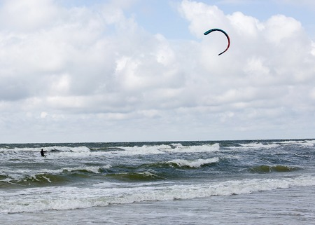 kiting: Kiting rider surfing on the waves with sail