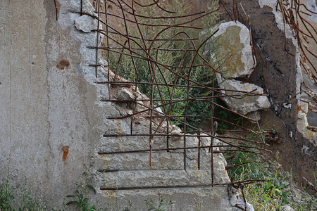 armature: Ruined building of a factory with concrete hanging on armature