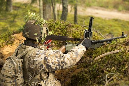 machine gun: Soldier with machine gun on the position