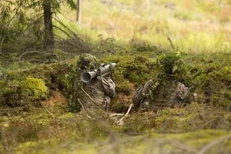 swat: soldier with a grenade launcher in the trenches Stock Photo