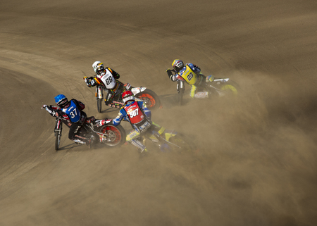 gran prix: DAUGAVPILS, LATVIA - JULY 18, 2015: 5th stage of speedway Gran Prix.  Speedway racers on the track Editorial