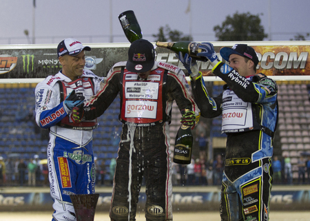 gran prix: DAUGAVPILS, LATVIA - JULY 18, 2015: 5th stage of speedway Gran Prix. Podium: Nicki Pedersen, Maciej Janowski Editorial