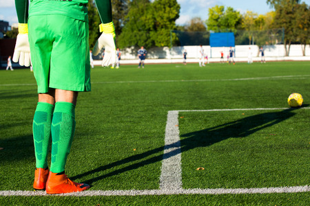 delirious: Football goalkeeper in green form and with shadow prepare for kick Stock Photo
