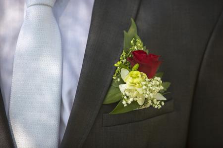 buttonhole: buttonhole on the lapel suit groom