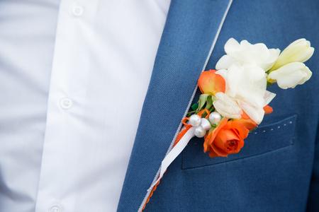 lapel: buttonhole on the lapel suit of groom