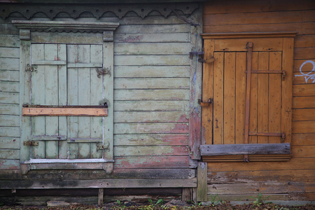 hinges: Old weathered closed shutters wooden window with hinges Stock Photo
