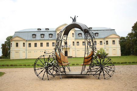 brougham: KRASLAVA, LATVIA - 15 September, 2015. Decorative Fairy Tale Forged Carriage in the park Editorial