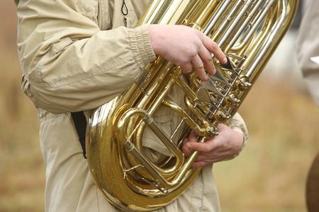 tuba: Musician play tuba play in orchestra outdoor