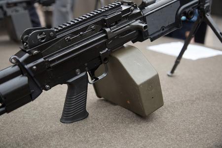 gun trigger: The part of machine gun - trigger and holder Stock Photo