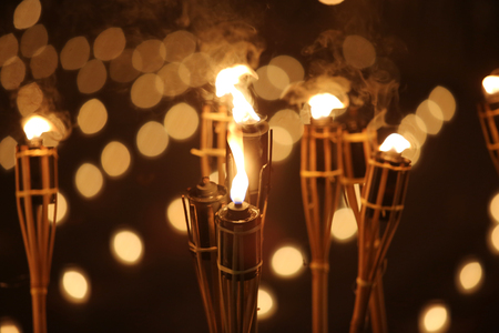torches at night with yellow flames and highlights Stock Photo