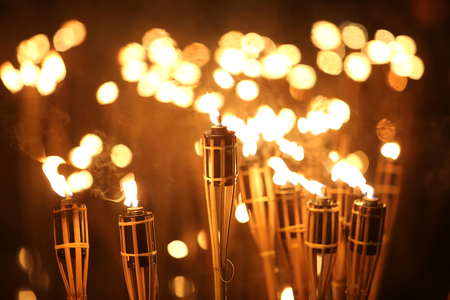 torchlight: torches at night with yellow flames and highlights Stock Photo
