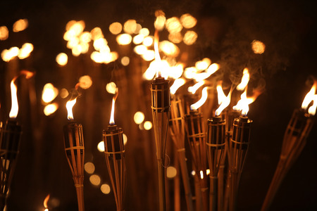 procession: torches at night with yellow flames and highlights Stock Photo