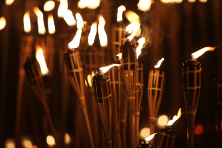 torches: torches at night with yellow flames and highlights Stock Photo