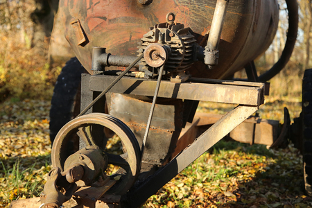 flywheel: Old rusty  Electric Motor and Flywheel outdoor