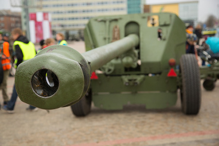 cannon gun: Foreground of Cannon gun barrel on the sity square