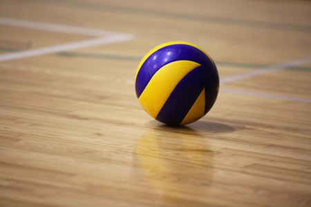 Volleyball ball on the floor of the hall