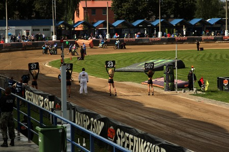 latvia girls: DAUGAVPILS, LATVIA - AUGUST, 17:  Latvian FIM Speedway grand prix. Girls with numbers on the start line Editorial