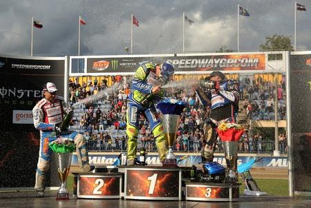 hancock: DAUGAVPILS, LATVIA - AUGUST, 17:  Latvian FIM Speedway grand prix. Riders on the podium poured by champagne, from left - Nicki Pedersen, Krzysztof Kasprzak, Greg Hancock Editorial