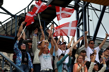 latvia girls: DAUGAVPILS, LATVIA - AUGUST, 17:  Latvian FIM Speedway grand prix. Fans from Denmark with flags on the tribune. Editorial