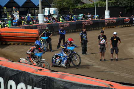 prix: DAUGAVPILS, LATVIA - AUGUST, 17:  Latvian FIM Speedway grand prix. Riders preparing for start Editorial