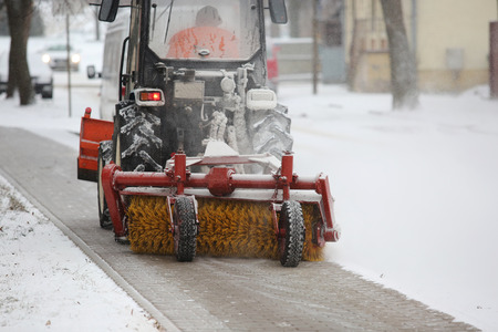 Machine for snow removal on the footpath