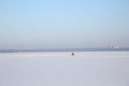 warm water fish: View of Winter fishing under the tent on the lake