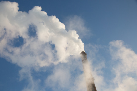 cold day: Smoke from chimney of thermal station. Frosty (cold) day