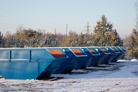 big bin: Row of blue large garbage containers at winter day on the open place