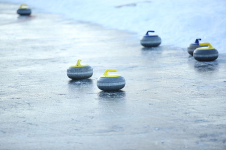granite stones for curling on ice of frozen lake