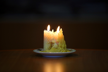 burning candle over black background with Warm Atmosphere