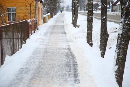 wayfarer: sidewalk in the snow-covered street in winter