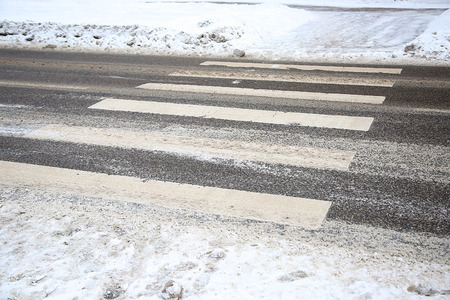 pedestrian crossing: pedestrian crossing with snow and tyre prints