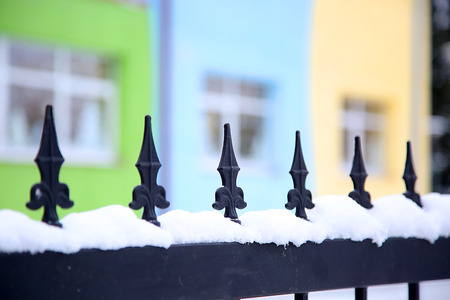 pointed: Pointed hammering at the gates covered by snow Stock Photo