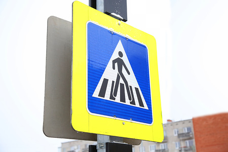 pedestrian crossing: pedestrian crossing sign outdoor in the winter time