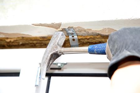 man with hammer make renovation indoor