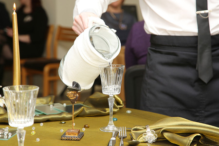 waiter serving mineral water in the glasses