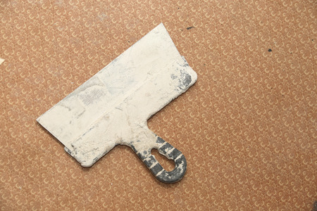 brushwork: Putty knife on the floor. Flat is under construction Stock Photo