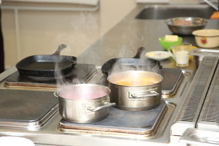 boiling pot: boiling pot on the stove of kitchen Stock Photo