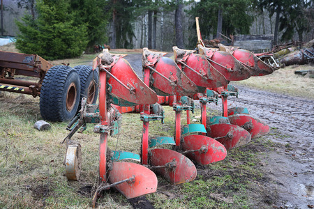 farm implements: large metal agricultural plow in the countryside