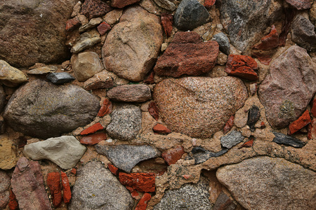 granite: Background of old granite stone with particles of red brick