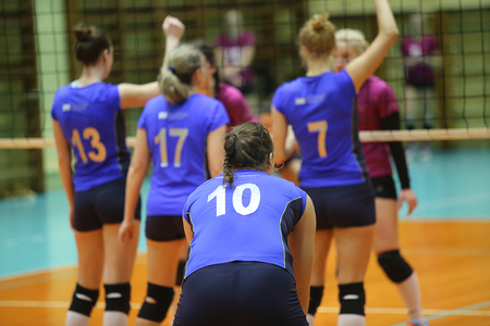 Episode of women's volleyball match, Players in blue uniform Standard-Bild