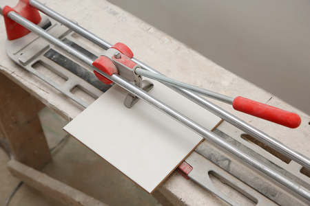 tile cutter: ceramic tile cutter with tile in the house