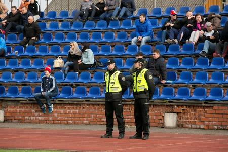 municipal editorial: DAUGAVPILS, LATVIA - April 3, 2016: Municipal police keep order on the footbal match in Daugavpils