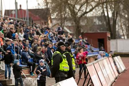 norm: DAUGAVPILS, LATVIA - April 3, 2016: Municipal police keep order on the footbal match in Daugavpils