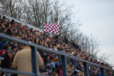 Polonia: DAUGAVPILS, LATVIA - April 10, 2016: fans in the stands with flag