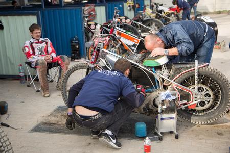 Polonia: DAUGAVPILS, LATVIA - April 10, 2016: Mechanic prepair motorcycle for race in paddock Editorial