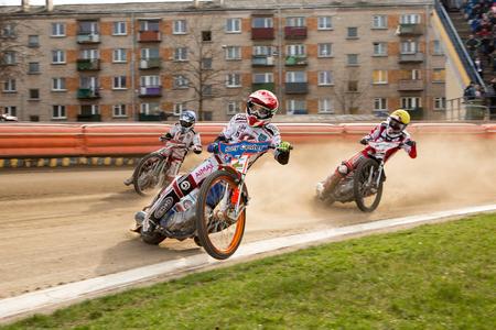 Polonia: DAUGAVPILS, LATVIA - April 10, 2016: Speedway riders on the track in match of polish NICE league Lokomotiv - Polonia